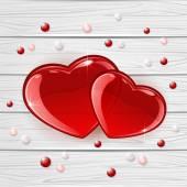 Dos corazones sobre fondo de madera — Vector de stock