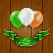 Patricks day balloons on wooden background — Vecteur