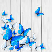 Blue butterflies on wooden background — Vecteur