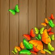 Colorful butterflies on wooden background — Stock Vector #71414289