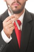 Business man holding an electronic cigarette — Stock Photo