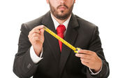 Business man holding a centimeter — Stock fotografie