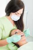 Female dentist checking oral hygiene — Stock Photo