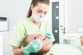 Periodic dental care in dentist office — Stock Photo