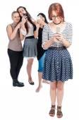 Bullying girls using smartphones — Stock Photo