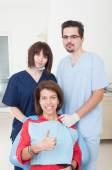 Dental team taking care of female patient — Foto Stock