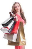 Satisfied shopping lady holding bags, card and wallet — Stock Photo