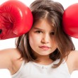 Young boxing girl acting angry — Stock Photo #66624597