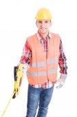 Professional builder unrolling an industrial meter reel — Stock Photo