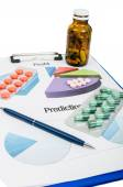 Profit and prediction for pills companies — Stock Photo