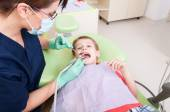 Scared child on drilling procedure in dentist chair — Stock Photo