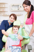 Happy child patient at dentist showing like — Stock Photo