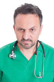 Face portrait of a young serious doctor — Stock Photo