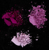 Close up of a make up powder on black background — Stock Photo