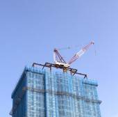 Construction site with tower crane — Stock Photo