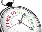 Time to go green concept clock — Stock Vector