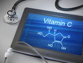 Vitamin C words displayed on tablet — Stockvector