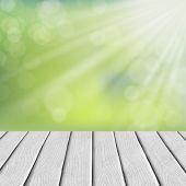 Wooden floor over blurred nature background — Stock Vector