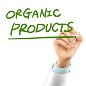 Doctor writing organic products words — Vetor de Stock