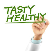 Doctor writing tasty healthy words — Vecteur
