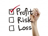 Investment checklist checking by hand — Stock Photo
