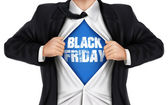 Businessman showing Black Friday words underneath his shirt — Stock Vector