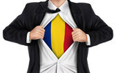 Businessman showing Romania flag underneath his shirt  — Stock Vector