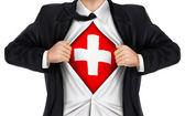 Businessman showing Switzerland flag underneath his shirt — Stock Vector
