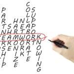 Teamwork concept crossword written by man's hand — Stock Photo #71566215