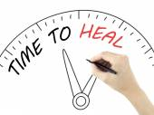 Time to heal written by man's hand — Stock Photo