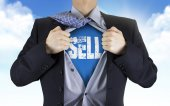 Businessman showing Sell word underneath his shirt — Stock Photo