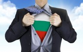 Businessman showing Bulgaria flag underneath his shirt — Stock Photo