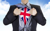 Businessman showing Great Britain flag underneath his shirt — Stock Photo