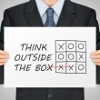 Businessman holding think outside the box poster — Stock Vector #80669588