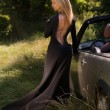 Sexy, elegant blonde woman in black long dress, outdoor, with cabrio car — Stock Photo #52138121