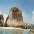 Huge rocks in Indonesia, blue ship and white dress woman — Stock Photo #52993719