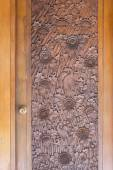Richly ornamented, wooden door in Indonesia — Stock Photo