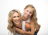 Beautiful laughing mother and child play together — Stock Photo