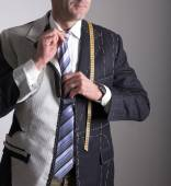 Semi-ready, elegant tailor made suit and man — Stock Photo
