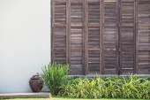Background white wall with latticed wooden doors in the tropical house — Stock Photo
