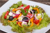 Fresh vegetable colorful greek salad in pate — Stock Photo