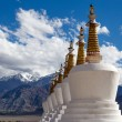 Buddhist chortens (stupa) and Himalayas mountains in the background near Shey Palace in Ladakh, India  — Stock Photo #70063627