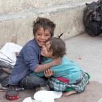 Постер, плакат: Beggar boy and girl in Leh India