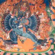 Masterpiece of traditional painting art about Buddha story on the temple wall in Tiksey Monastery. Ladakh, India — Stock Photo #70073573