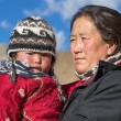Old local woman with the child in Ladakh. India — Stock Photo #70094345