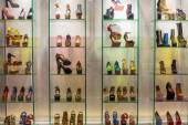 Lot women shoes brand name - Jeffrey Campbell Shoes on a glass shelf at the Siam Paragon Mall.  Bangkok, Thailand. — Stock Photo