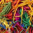 Lots of colorful, wicker bracelets on buddhist market near the temple in Dharamsala, India — Stock Photo #70702227