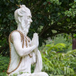 Traditional stone sculpture in garden . Island Bali, Ubud, Indonesia — Stock Photo #71053889