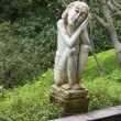 Traditional stone sculpture in garden . Island Bali, Ubud, Indonesia — Stock Photo #71055877