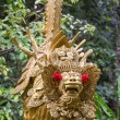 Traditional stone sculpture in garden . Island Bali, Ubud, Indonesia — Stock Photo #71056383
